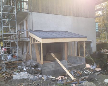 Extension with single ply roofing